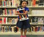 طفلة بدون كفين تفوز بمسابقة لجمال الخط